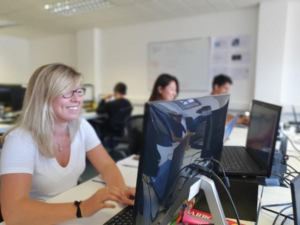Tara at her desk