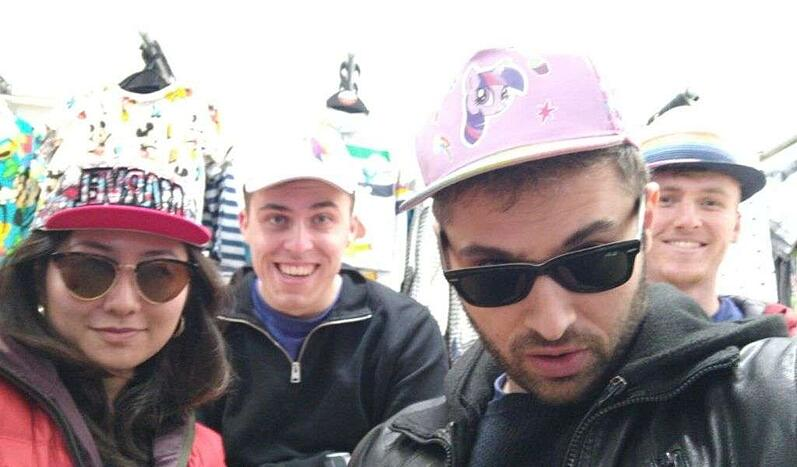 A picture of Ayaka and Luke (left to right in the front) and Will and Jack (left to right at the back) wearing hats.
