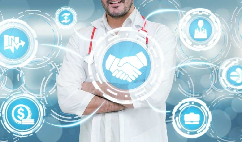 A doctor with health insurance related icon graphic interface