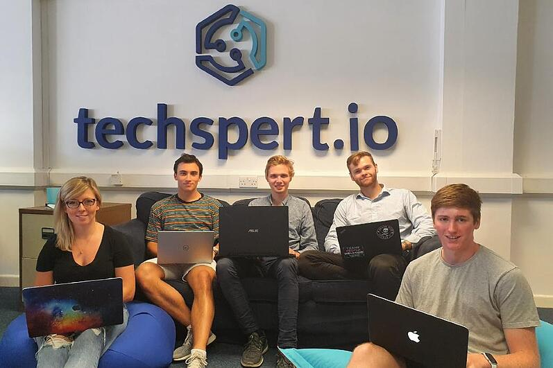 Interns with techspert sign