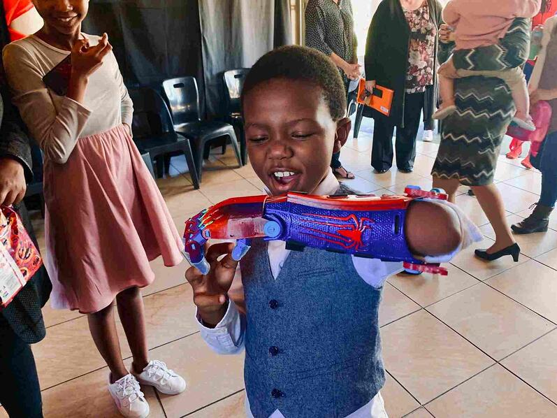 Nine-year-old South African student, Aphelele Gumede, enjoying his Spider-Man 3D prosthetic limb