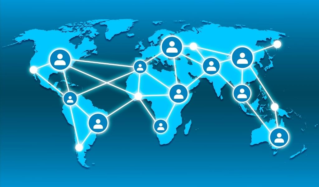 An image of a world map showing a network connection of people
