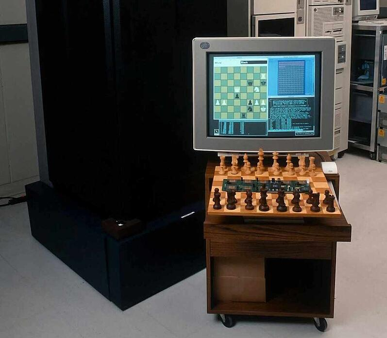 A photo of Deep Blue and a chess board