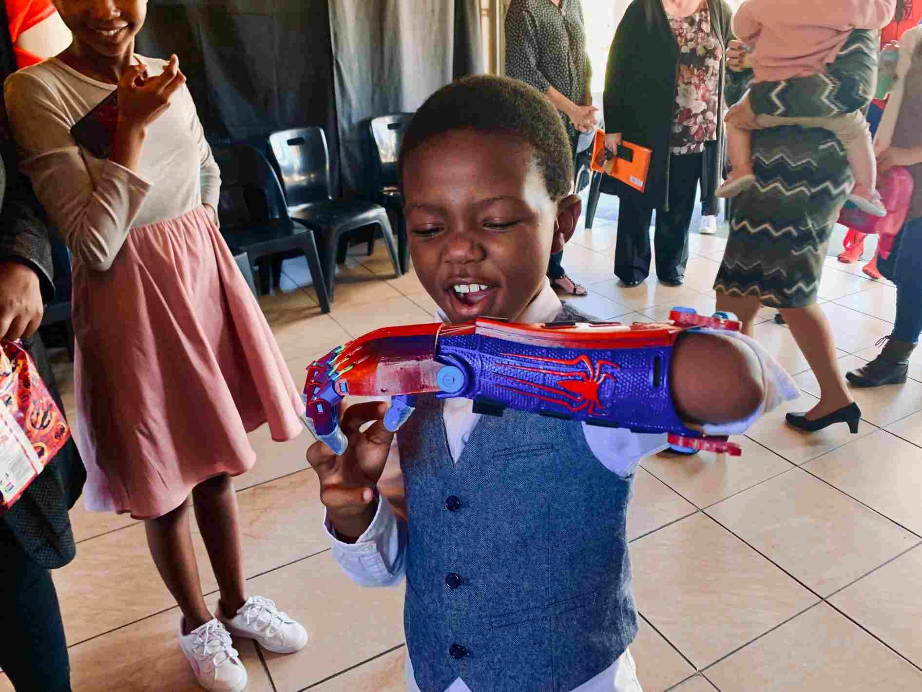 Nine-year-old South African student, Aphelele Gumede, enjoying his Spider-Man 3D prosthetic limb.